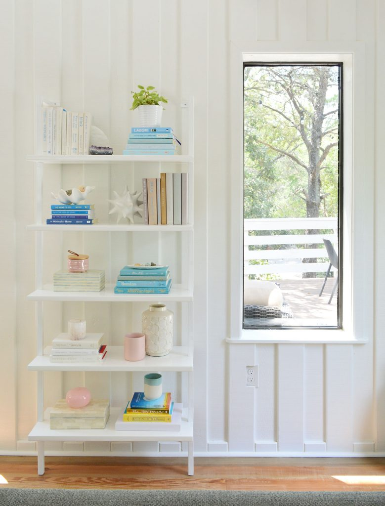 Tall Bookcase Against Wall In Beach Living Room