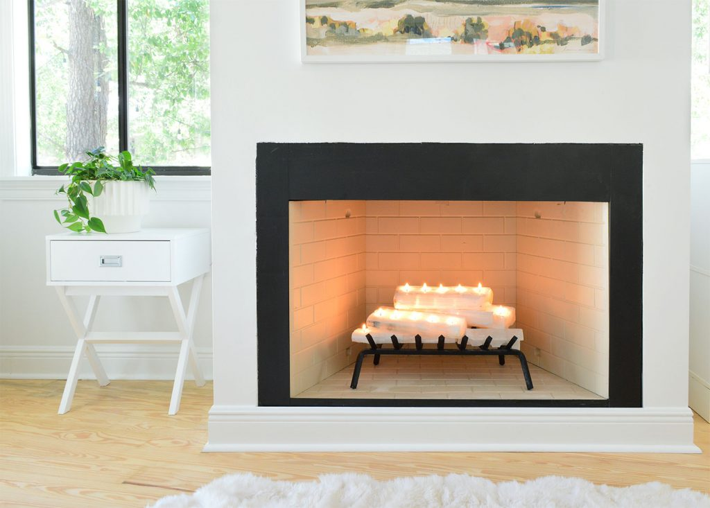 Straight shot of fireplace with crystal logs lit