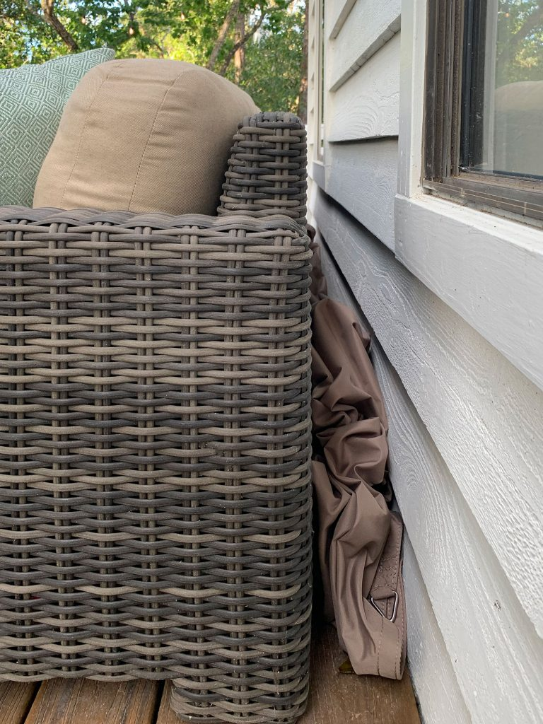Sun Sail Cover Stuffed Behind Outdoor Sofa
