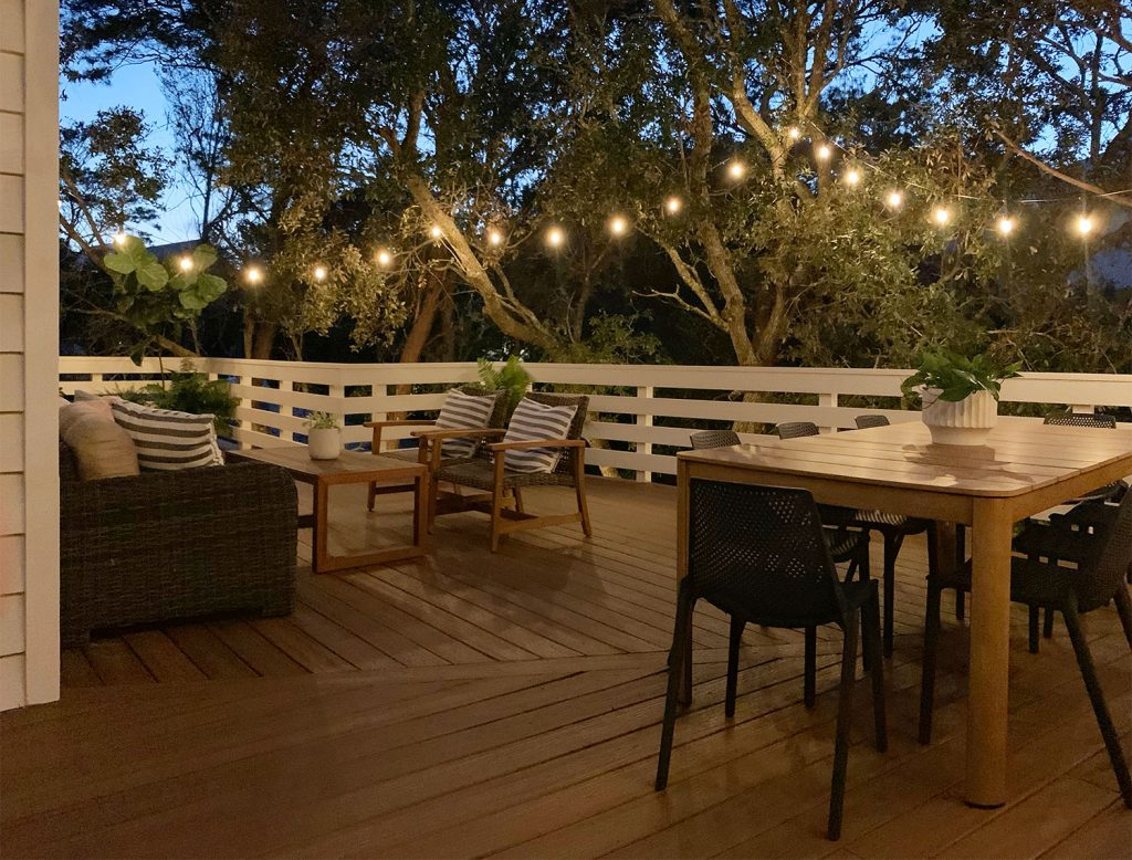Nighttime View Of Large Deck With String Lights