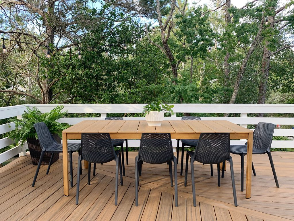 Metal Outdoor Dining Table With Eight Black Plastic Chairs