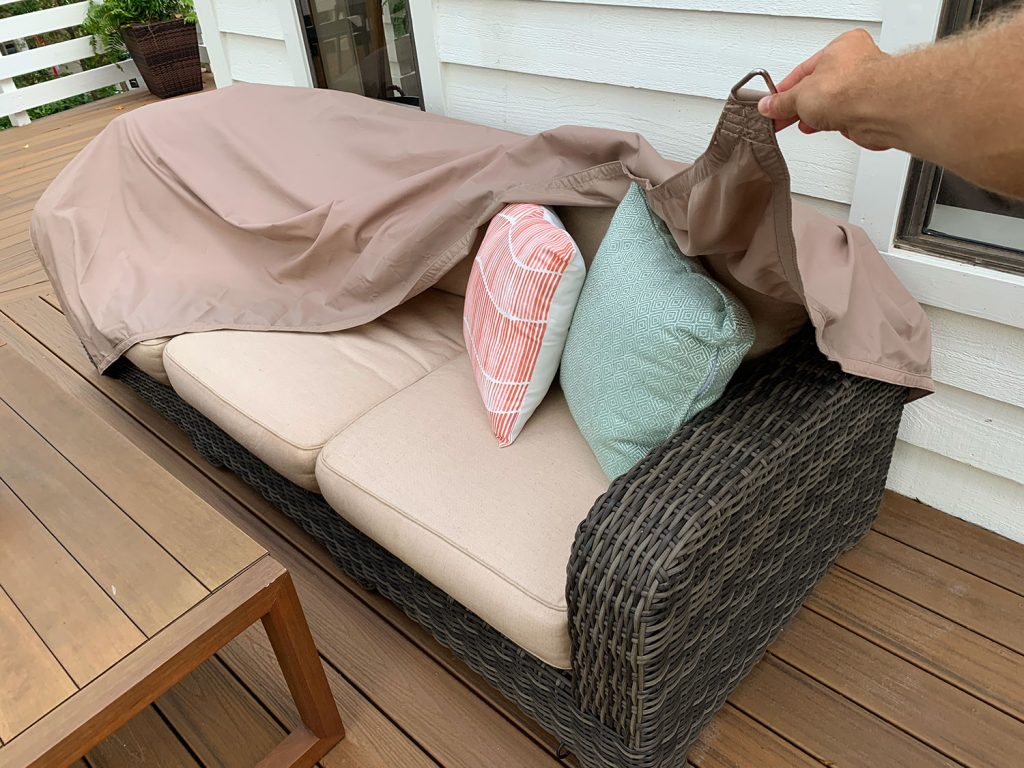 Waterproof Sail Shade Cover Being Pulled Over Outdoor Couch