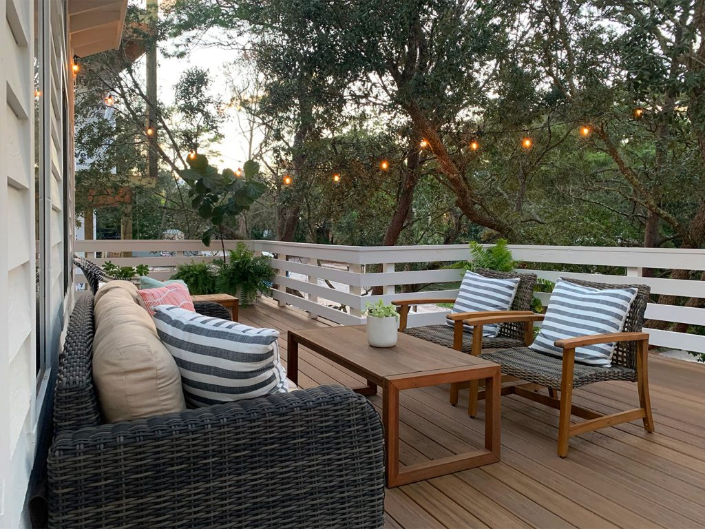 Dusk View Of Outdoor Deck Surrounded By Trees