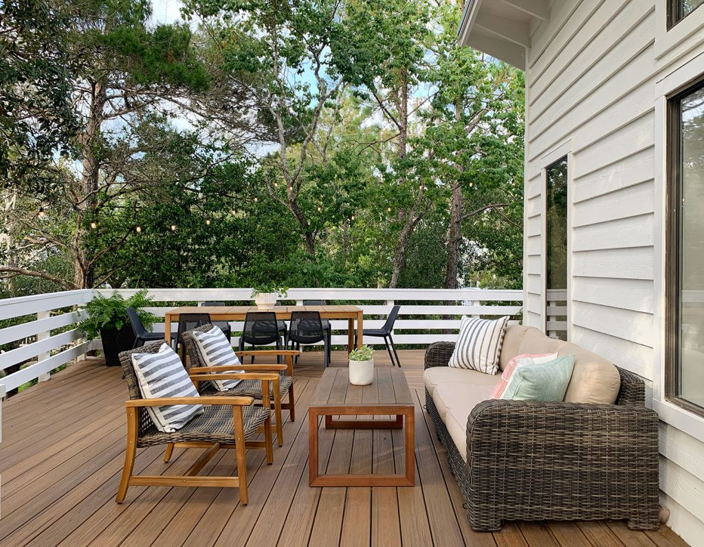 Deck Seating Area With Outdoor Couch Table And Two Woven Lounge Chairs
