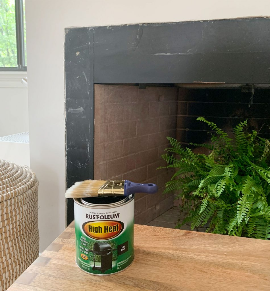 Can of Rust-Oleum High Heat black paint sitting in front of fireplace