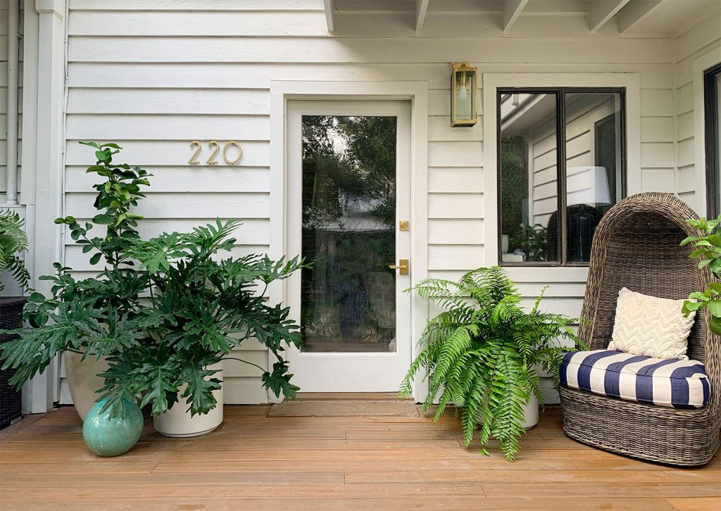 Front Porch With Glass Door And Lots Of Plants