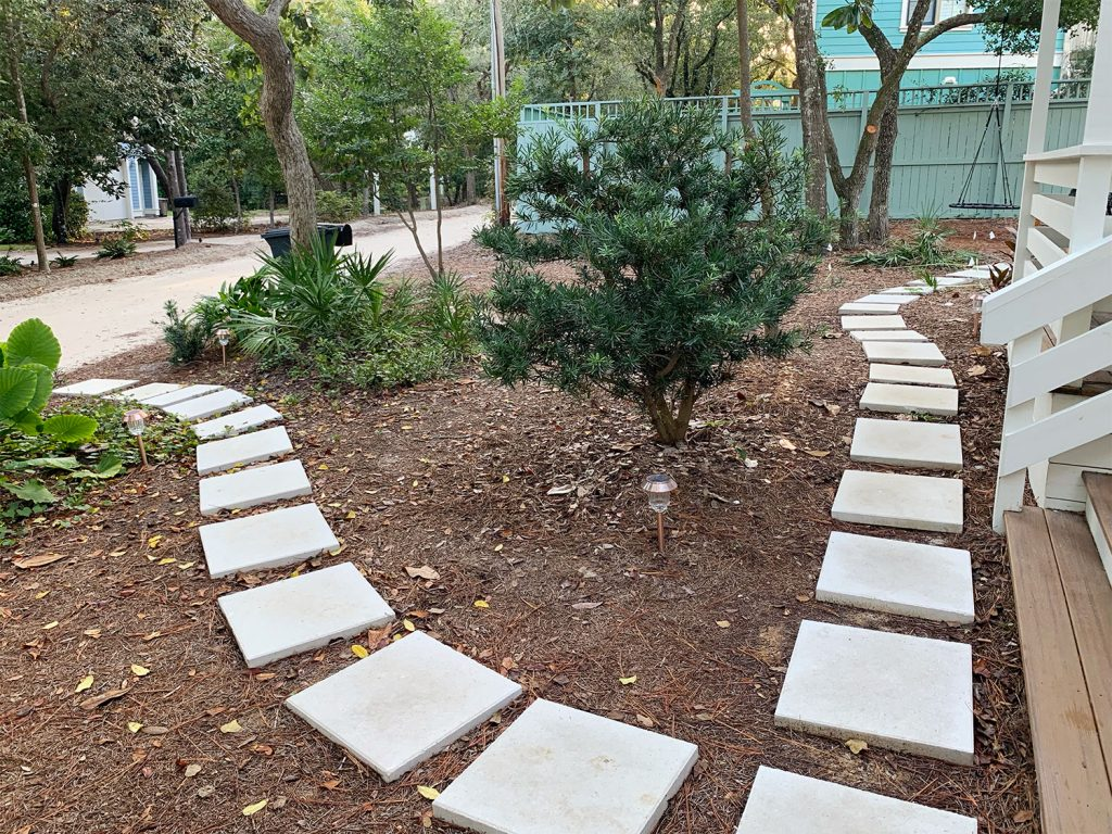 Square White Paver Pathway Around Mulched Front Yard