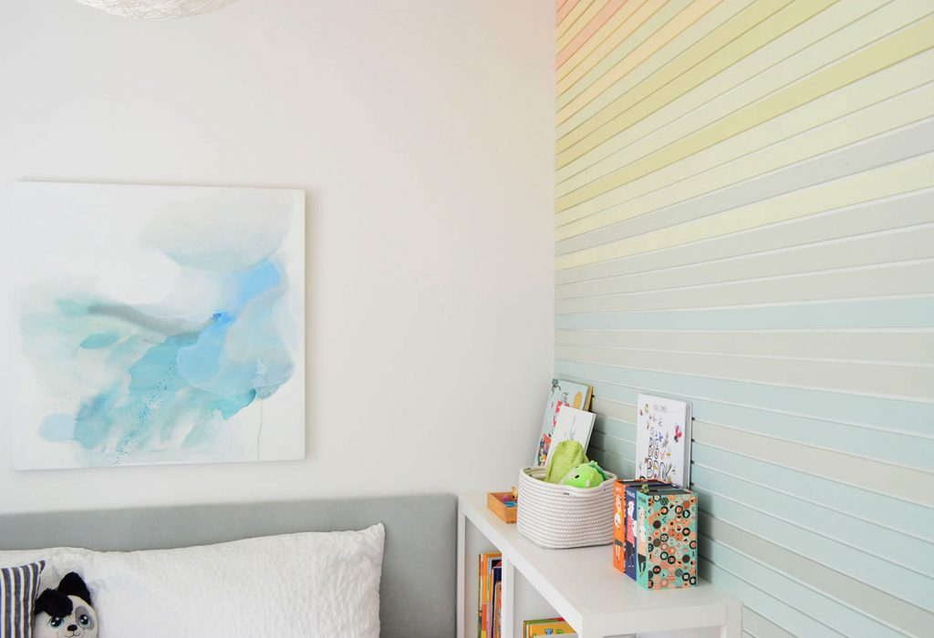 Abstract Blue Painting Next To Rainbow Stripe Wall Treatment