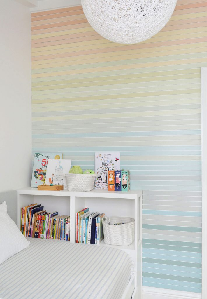 Full View From Ceiling To Floor Of Rainbow Gradient Striped Wall Treatment In Boys Room