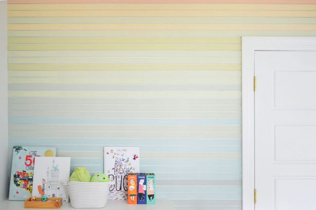 Wide View Of Colorful Stripe Wall Treatment Going Around Bookcase And Closet Door