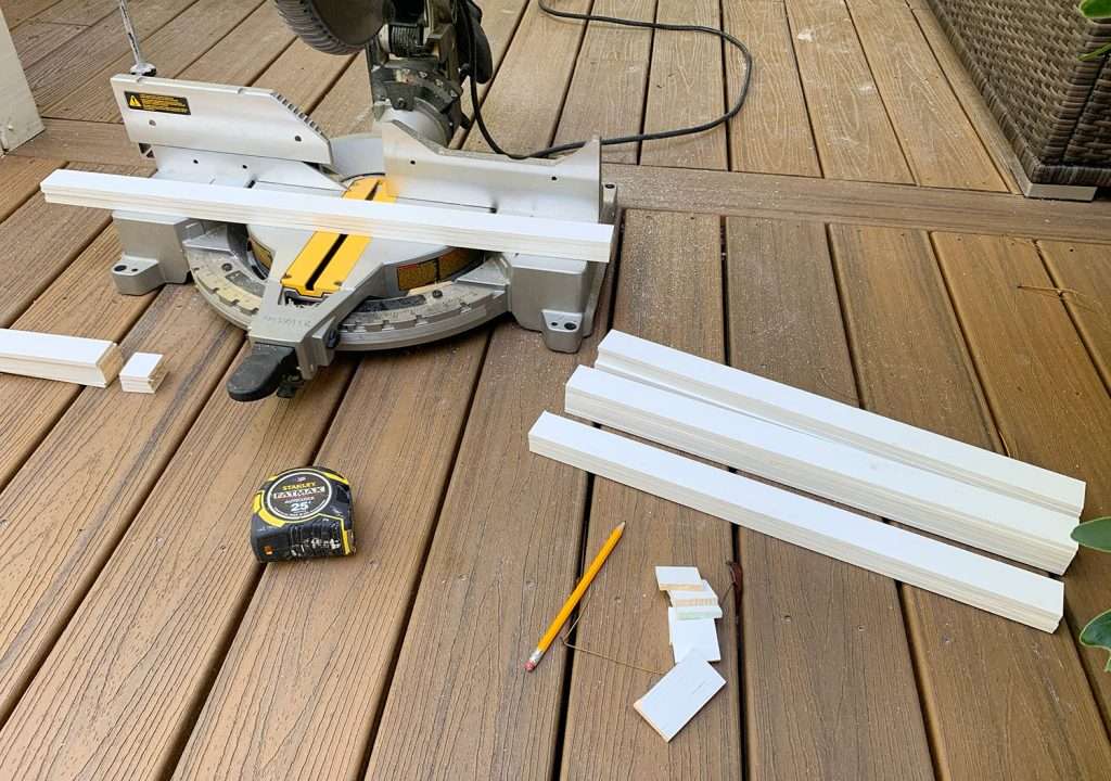 Miter Saw On Deck With Cut Pieces Of White Lattice