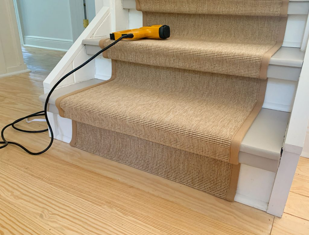 Bottom Step Of Staircase Showing Folded End Of Sisal Stair Runner