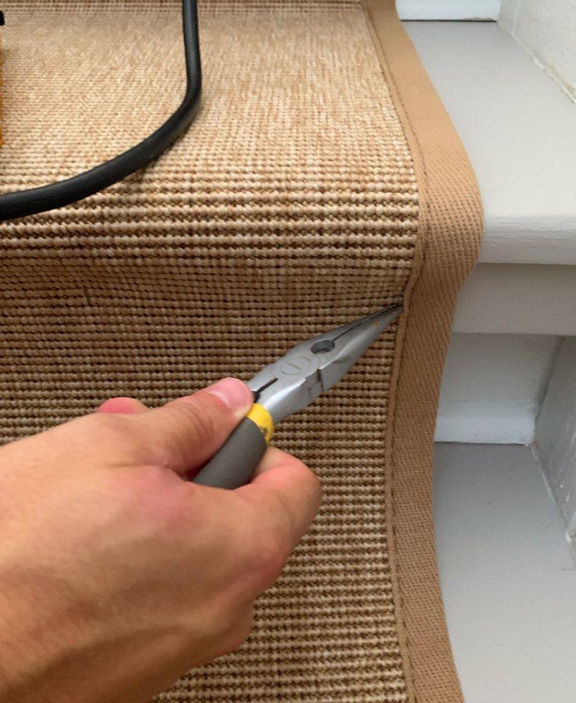 Needlenose Pliers Removing Staple On Sisal Stair Runner
