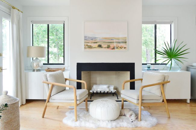 Symmetrical White Ikea Besta Cabinets On Either Side Of Bedroom Fireplace