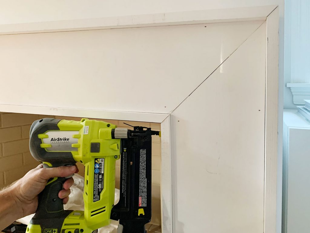 Nail Gun Securing Inner Border Pieces Around Inside Of Mantel