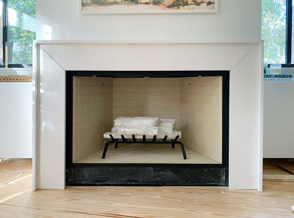 Mantel With White Trim Pieces Added Around Outside To Add Depth