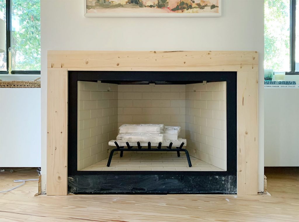 Mantel Brace Piece Made Of Raw Wood Surrounding Fireplace On 3 Sides
