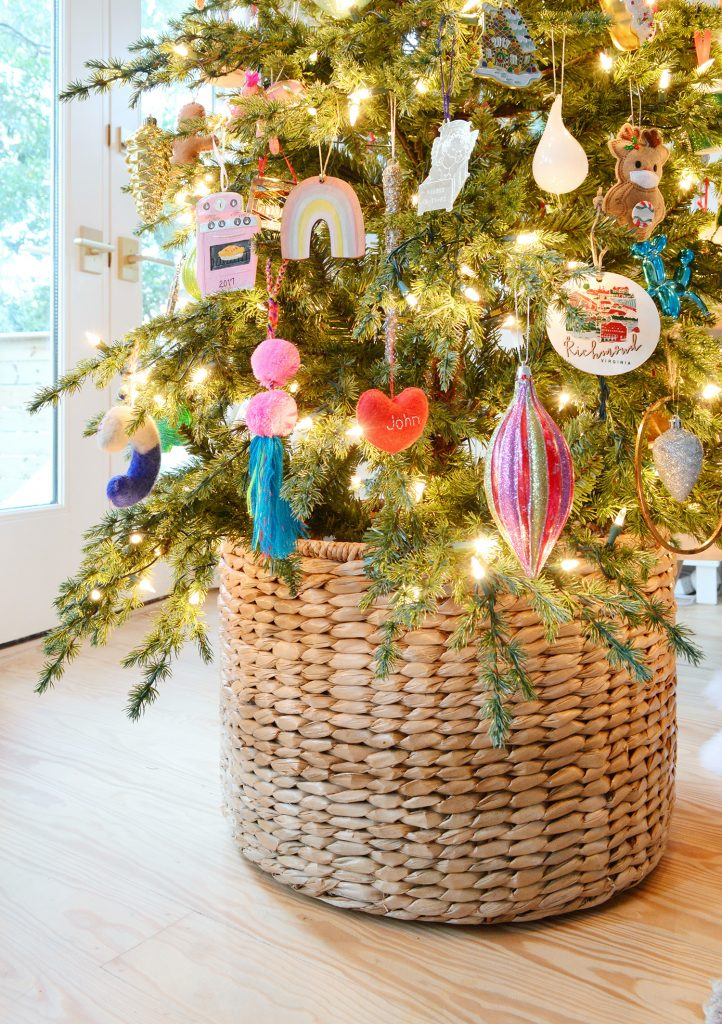 Woven Basket At Base Of Christmas Tree With Colorful Ornaments