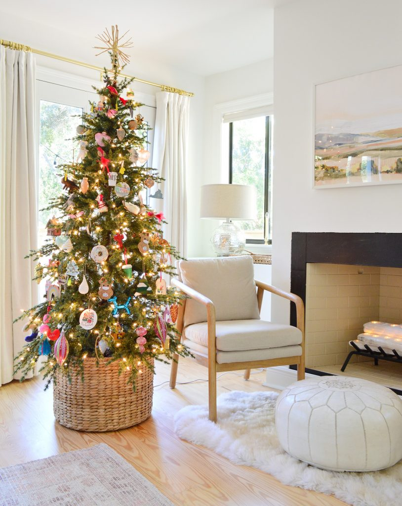 Christmas Tree in Woven Basket Near Fireplace