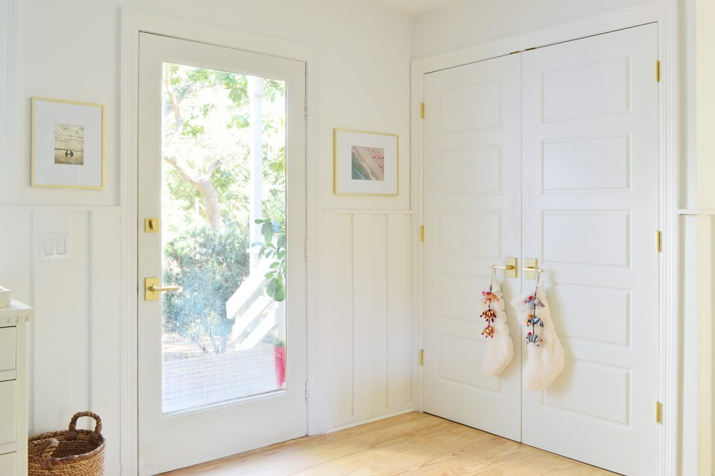 Front Door Next To Laundry Closet With Stockings On Handle