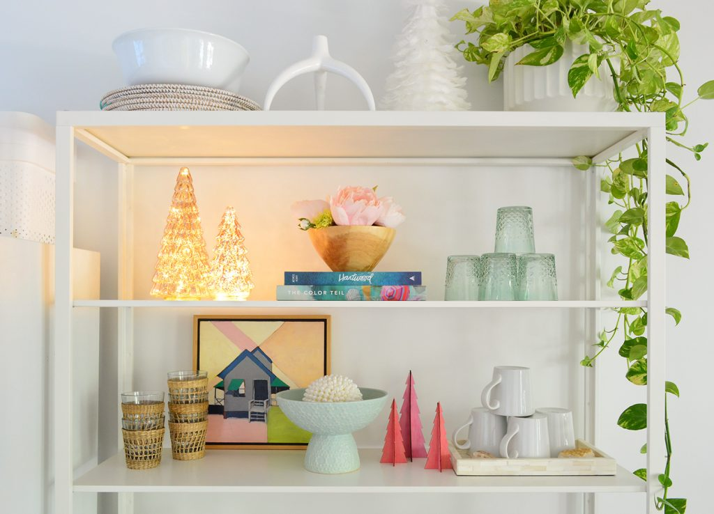 White Metal Kitchen Shelves With Lighted And Colorful Christmas Trees
