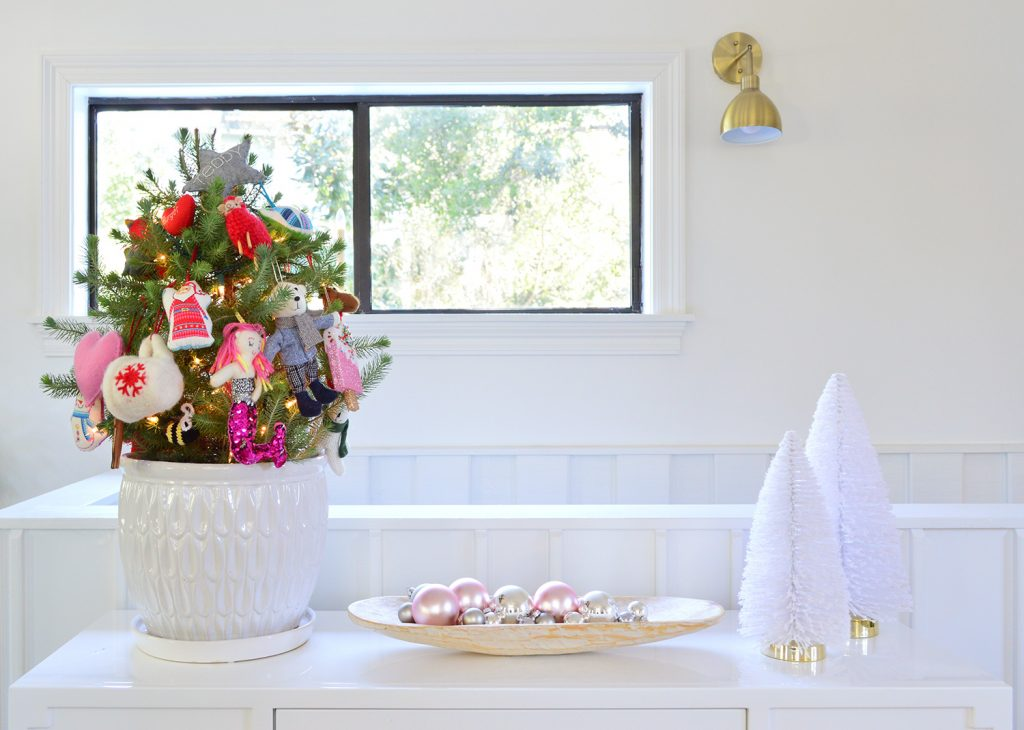 Whit Tabletop With Small Tree Shiny Ornaments And Bottlebrush Trees