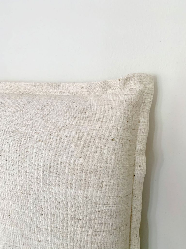 Close up detail of french seam on edge of linen headboard