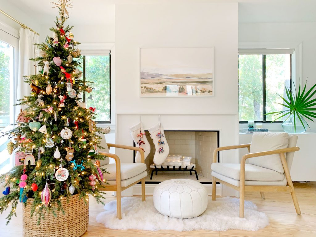Bedroom fireplace scene with Christmas tree chairs and stockings