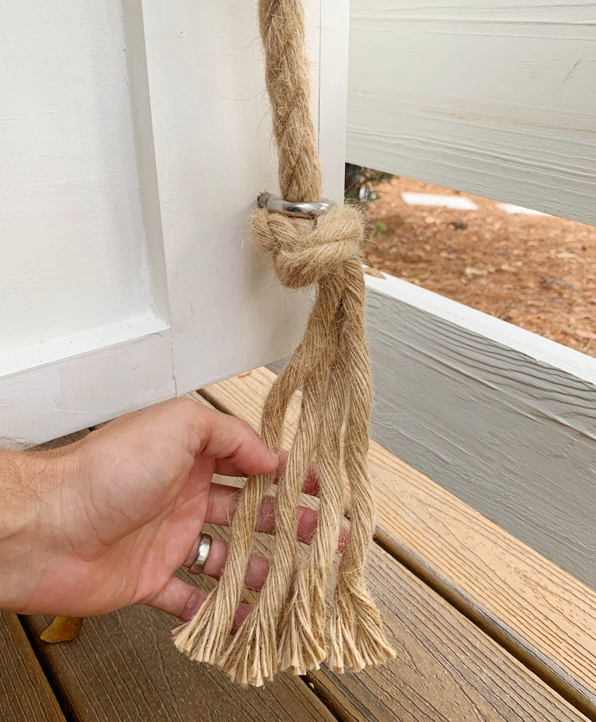 Frayed rope under the bottom of daybed eye hook