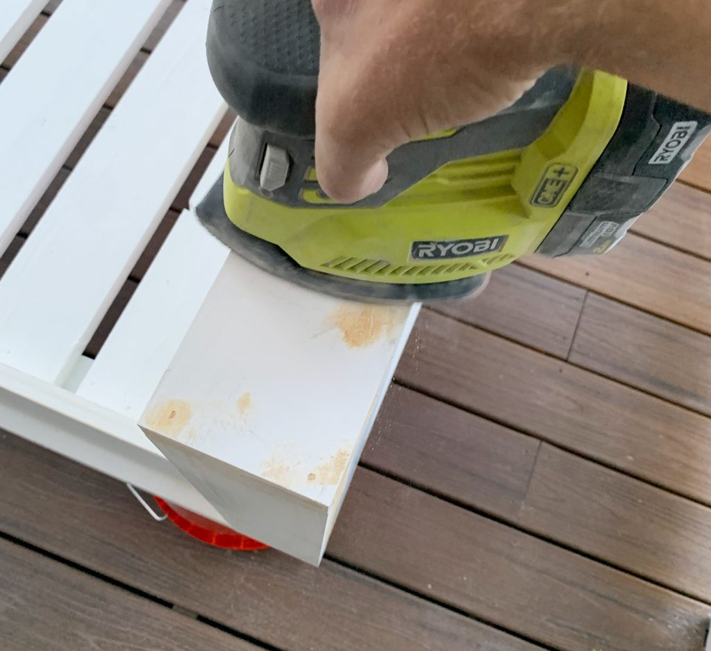 Sanding wood filler on daybed with ryobi palm sander