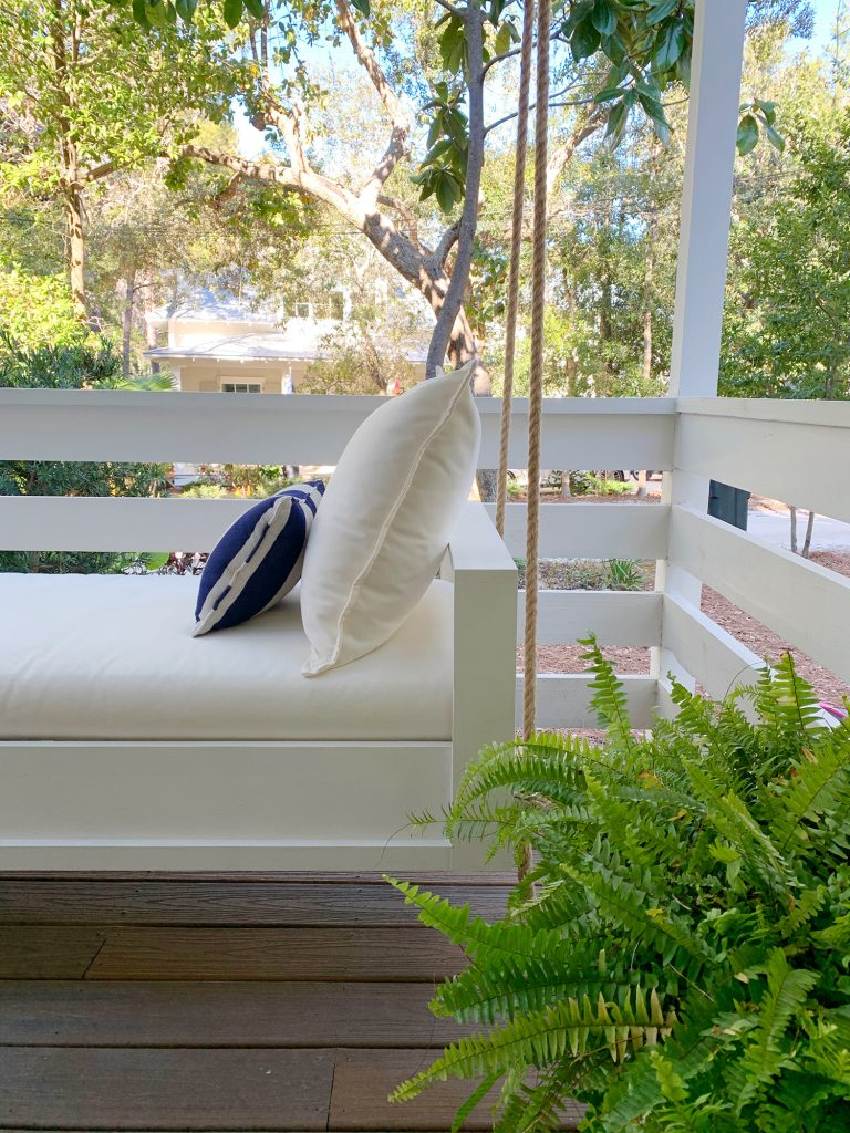 Side View Of Finished White Hanging Daybed With Cream Cushion