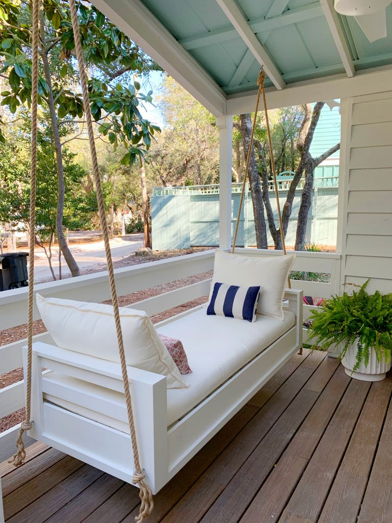 Angled View Of Finished Outdoor Hanging Daybed With White Cushions