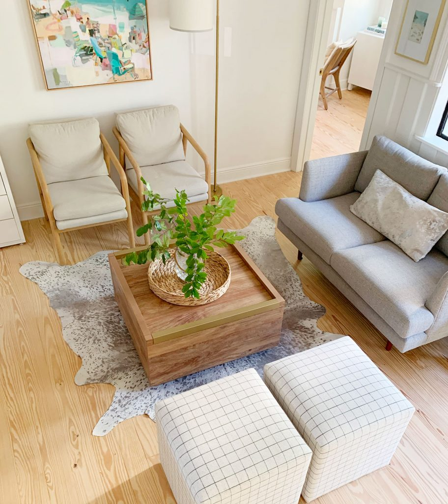 Overhead view of sitting area with wood coffee table in middle