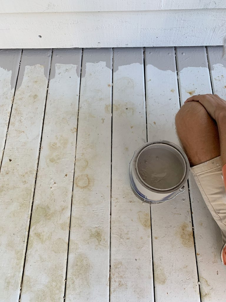 White painted porch floor stained with leaf marks