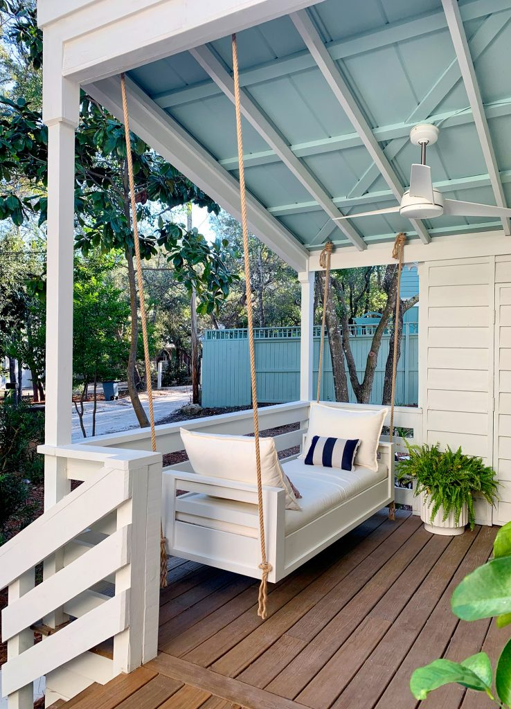 Outdoor Hanging Daybed Hung With Rope In Four Spots Under Covered Porch Ceiling