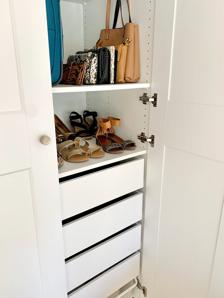 View inside Ikea Pax wardrobe with shoes and purses
