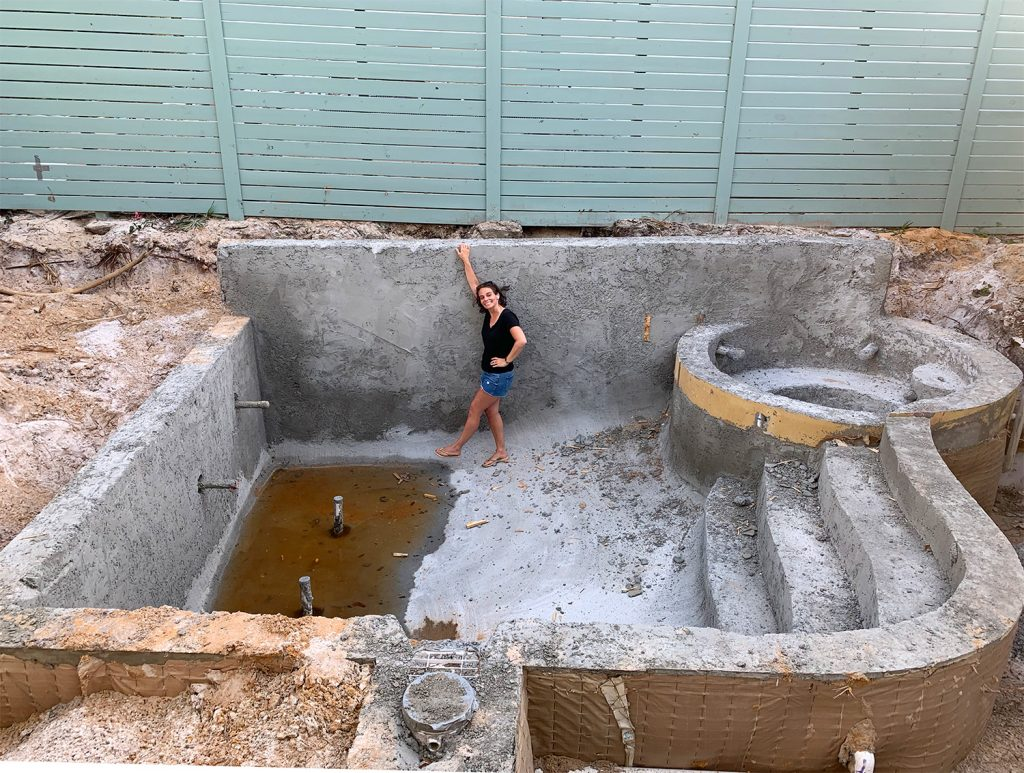Sherry standing in concrete pool form