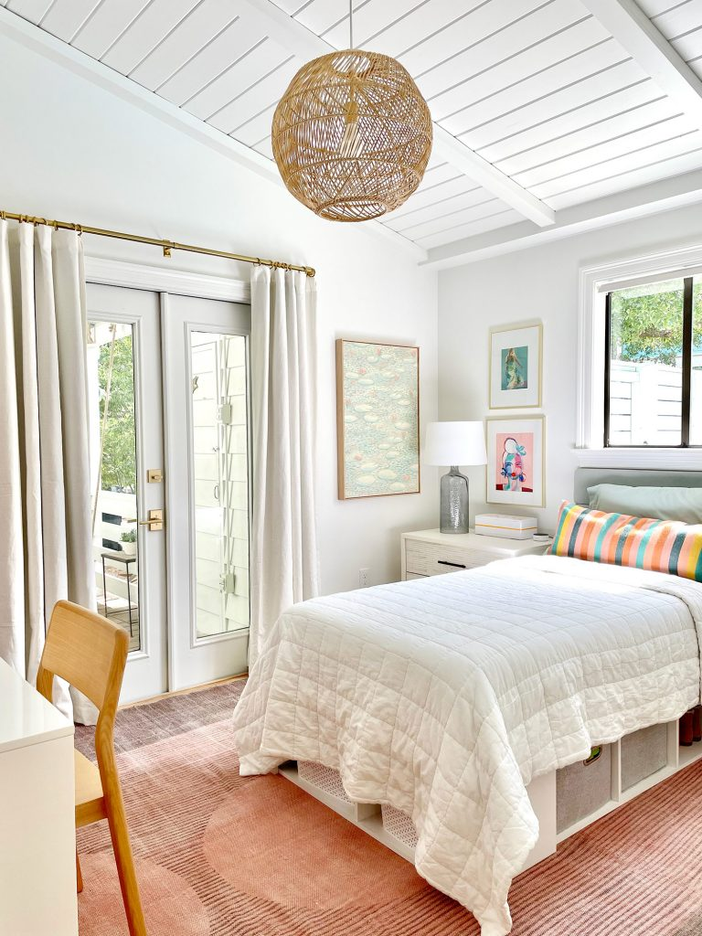 Girls Bedroom With Lofted Plank Ceiling And Pink Rug