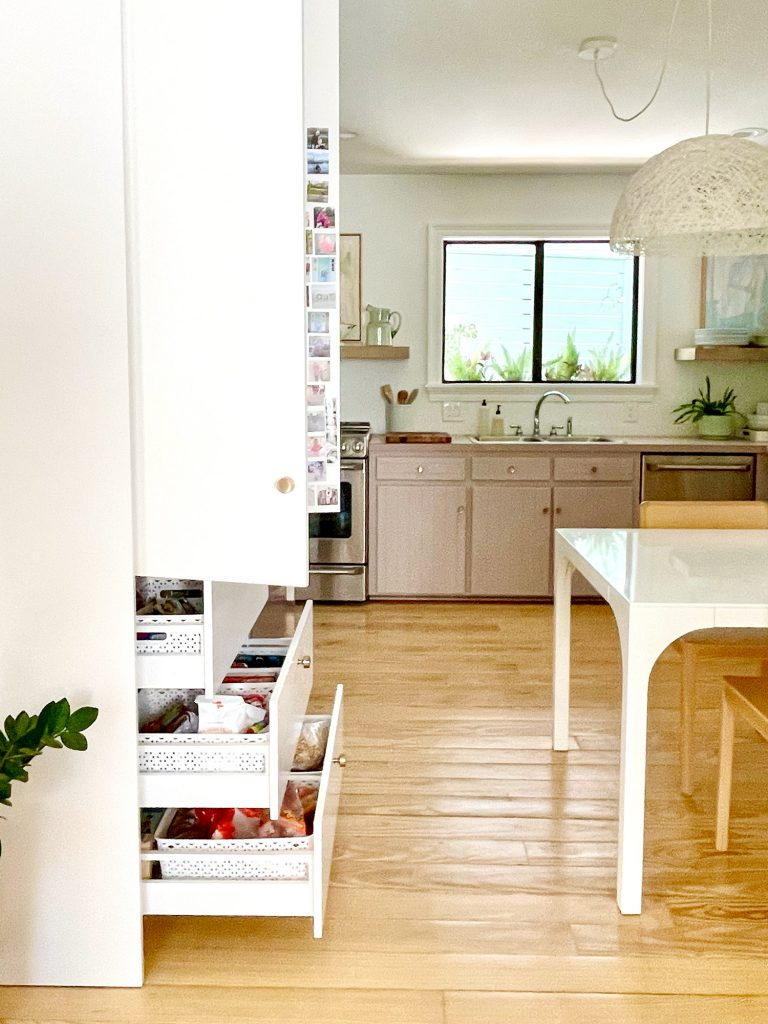 Ikea Built-In Pantry With Lower Drawers Open to Show Walking Space