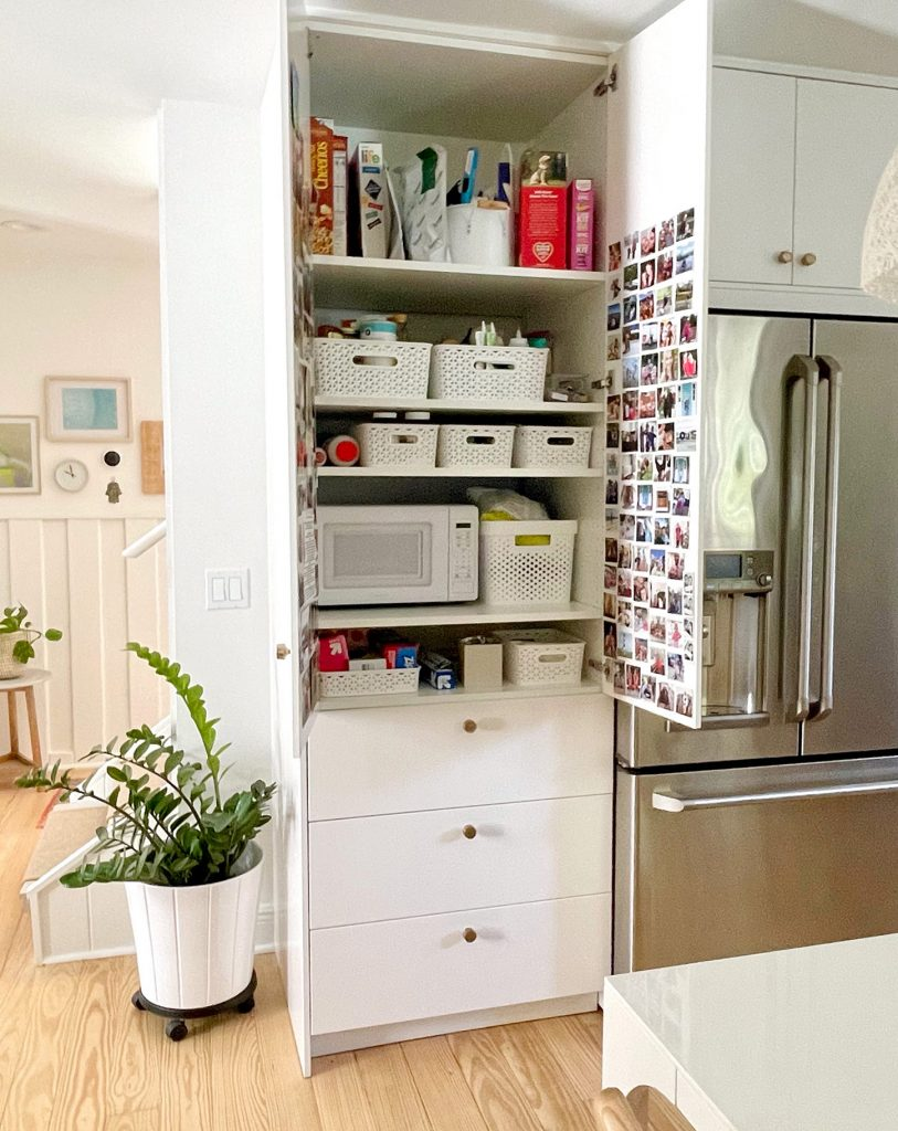 Ikea Kitchen Built-In Pantry With Doors Open to Show Shelf Organization With Baskets