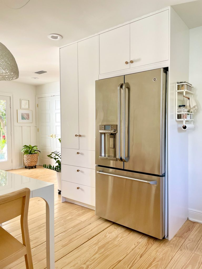 Ikea Built-In Pantry Cabinets Around Stainless Steel Refrigerator