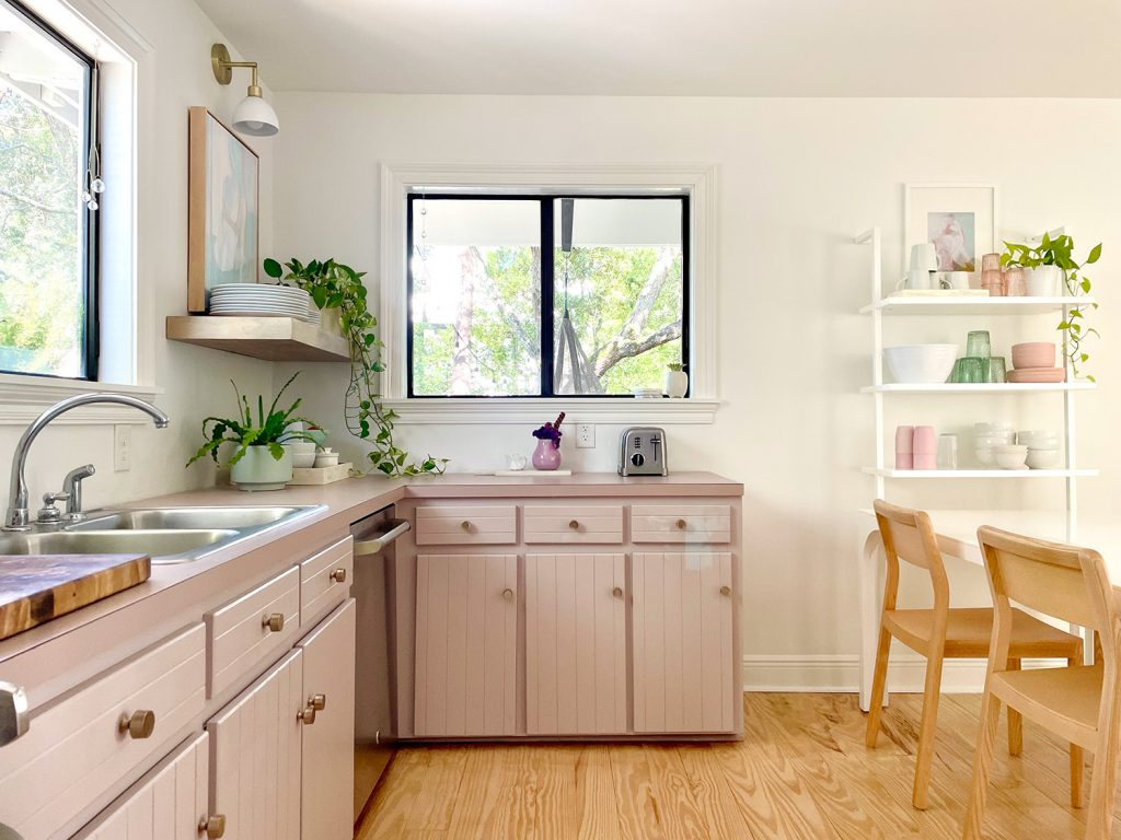 Mauve Painted Kitchen Cabinets With View Through Window And Open Shelves