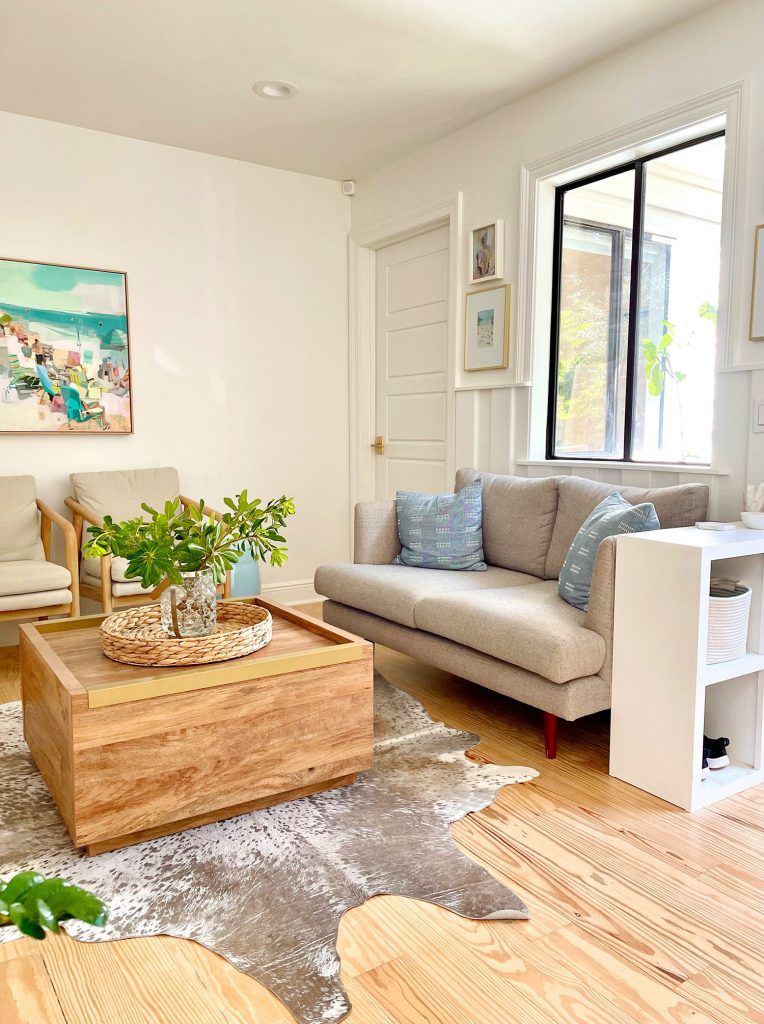 Kitchen Sitting Area With Gray Loveseat Wood Coffee Table Cowhide Rug And Storage Cubby