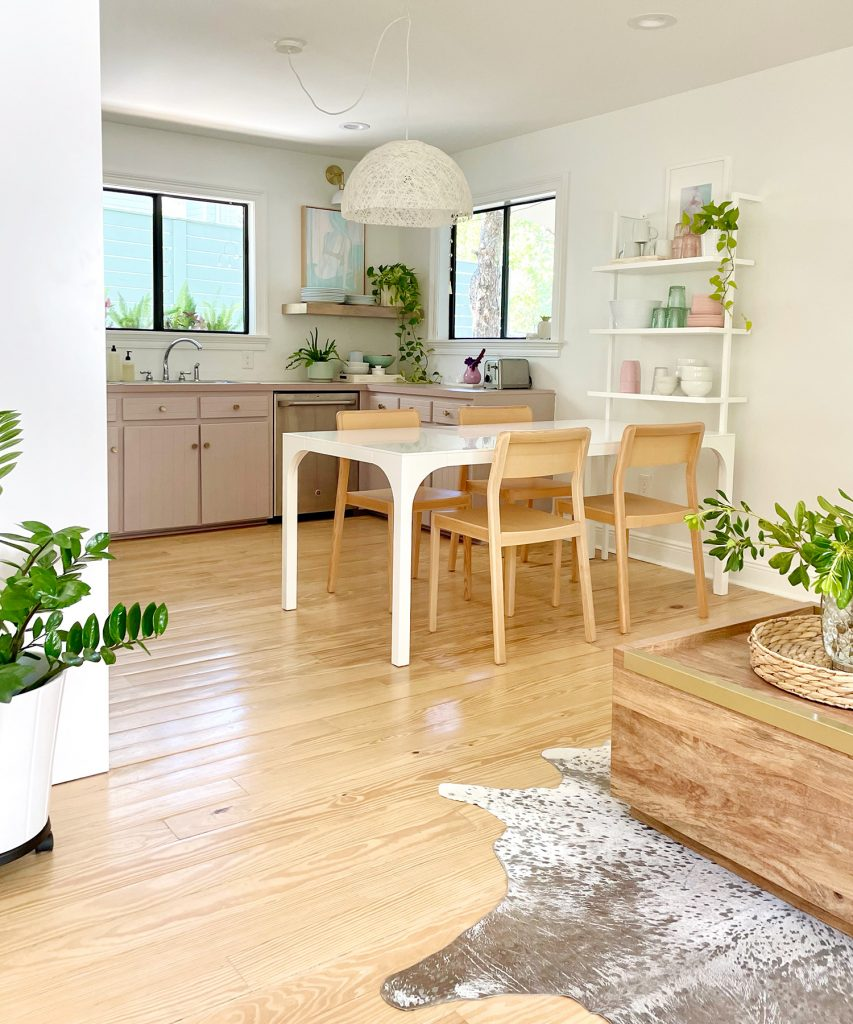 Vertical View Of Walking Space To Beachy Kitchen With Wood Furniture And Mauve Cabinets