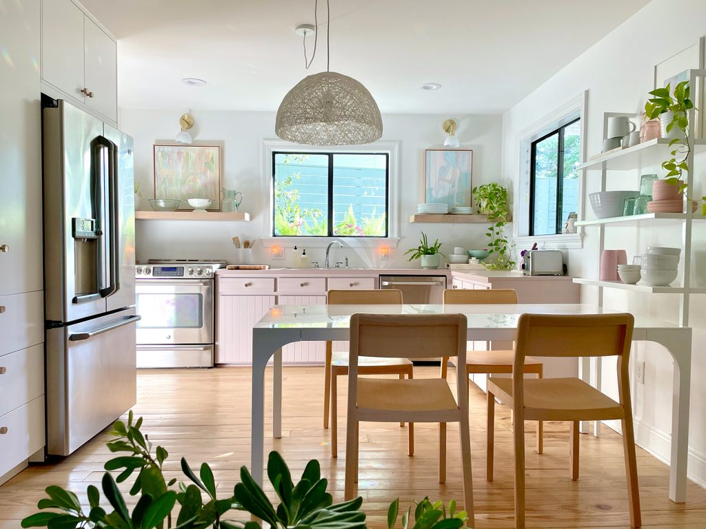 Closer View Of Beachy Kitchen From Sitting Area With Dining Table And Built In Pantry