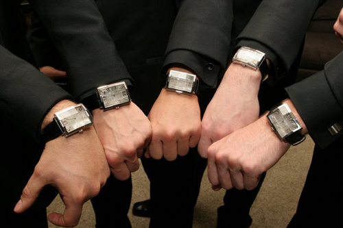 ... elegant matching watches from the groom (for their groomsman gift