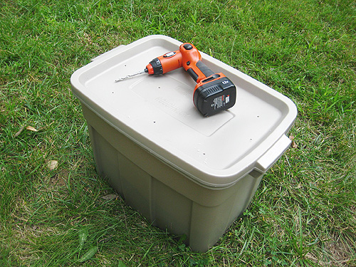 completed diy compost bin in plastic container
