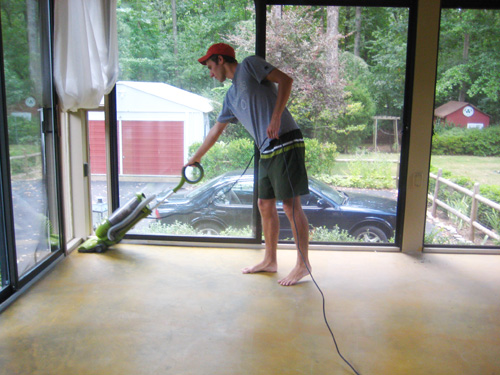 cleaning concrete floor in glass doored sunroom prior to DIY stain application using a vacuum