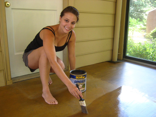 Lying Behr Semi Transpa Concrete Stain To Floor Using A Paintbrush