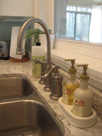 satin nickel arched kitchen faucet with sprayer and farmhouse pump style control